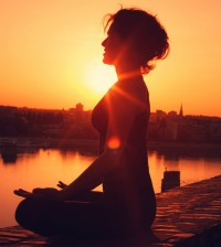 woman doing guided meditation